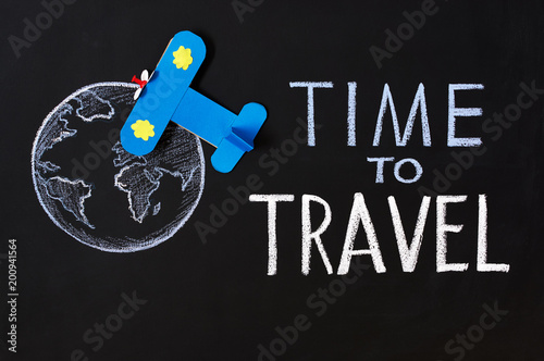 Chalk Inscription Time To Travel On A Blackboard Globe And Plane Against