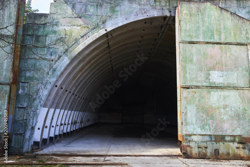 Abandoned old military hangar for storage and maintenance of fighter jets and o Canvas Print