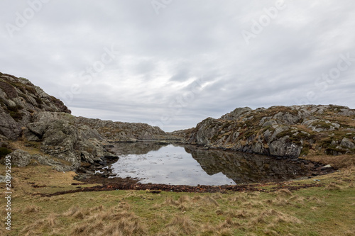 Foto op Plexiglas Noord Europa Beautiful landscape with a calm bay in the Rovaer island in Rovaer archipelago in Haugesund, Norway.