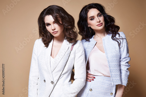 Two Sexy Beautiful Woman Business Lady Pretty Face Makeup Dark Long Hair Wear Dress Code Suit Jacket Skirt Blouse Fashion For Office Style Boss Manager Clothes Friend Colleague Accessory Bag Studio