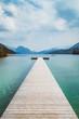 Wooden landing stage at alpine lake in summer