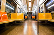 New York City subway car interior with colorful yellow and orange seats
