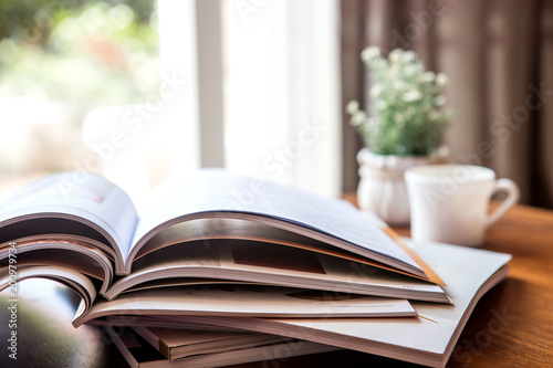 Fotografia, Obraz  selective focus of  stacking magazine place on table in living room