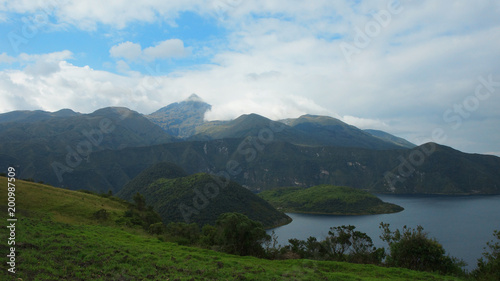 Foto op Aluminium Zee / Oceaan View of the Cuicocha lagoon with the Cotacachi volcano among the clouds in the background in the province of Imbabura - Ecuador