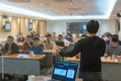 Fotografía  Rear view of Asian Speaker with casual suit in gesture action when present the k