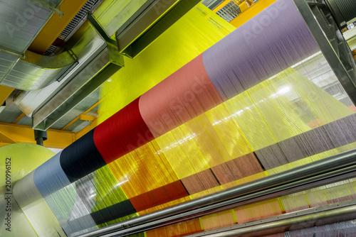 Fotografiet  weaving loom at a textile factory, closeup
