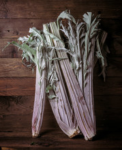 Whole Uncooked Cardoon On Rustic Wooden Board