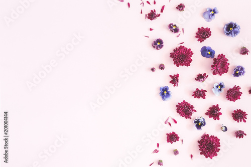 Flowers composition. Frame made of colorful flowers on pink background. Flat lay, top view, copy space