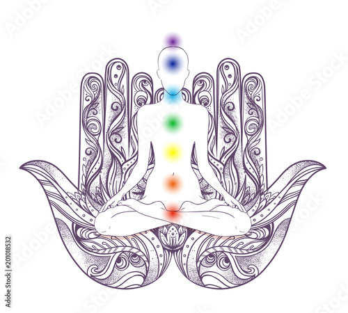 Photo  Human silhouette sitting in lotus position with chakras over hamsa symbol on background