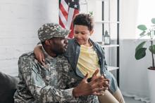 African American Boy Hugging A...