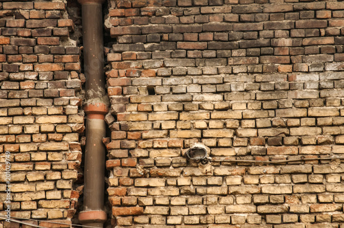 Photo  Old grunge weathered brickwall with stoneware vitrified clay ceramic drain sewer
