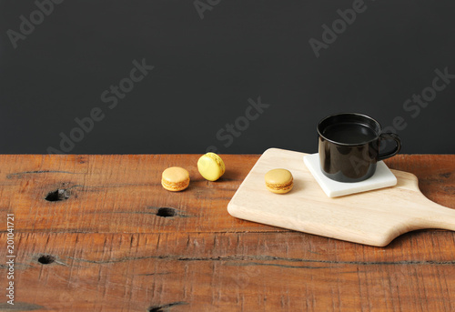 Poster Macarons Mug with sweet macarons placed on wooden board