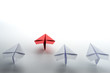 Leinwanddruck Bild - Red paper plane on white background, Business competition and Leadership concept.