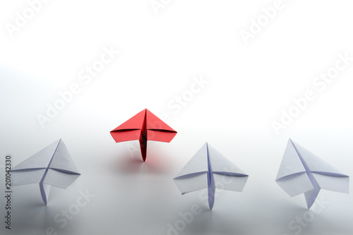 Photo Red paper plane on white background, Business competition and Leadership concept