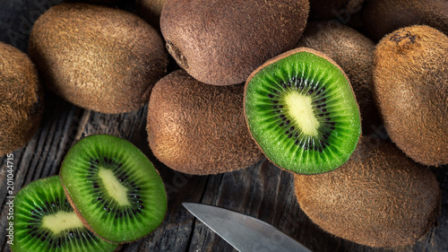 Kiwi fruits on wooden background