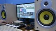 Musician composes track using drum machine. vibration of speakers from loud music.