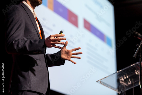 Speaker at business conference or presentation Fotobehang