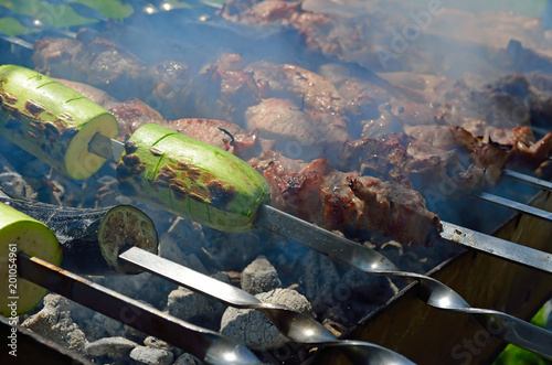Foto op Aluminium Draken Marinated shashlik with squashes preparing on a barbecue grill over charcoal. Outdoor recreation.