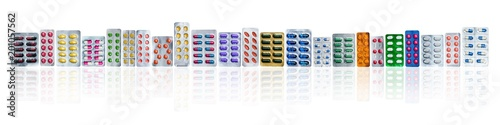 Many of colorful pills in blister packs in a row isolated on white background with copy space Canvas Print