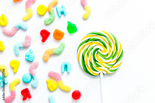 lollipop design with sugar candys on white background top view m