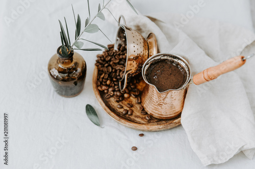 Stampa su Tela Traditional Turkish coffee in Cooper with decorations on rural linen background