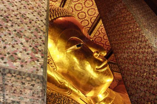 Golden reclining Buddha statue at the Wat Pho Temple, Bangkok, Thailand Poster