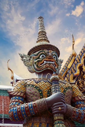 Wall Murals Place of worship Statue of Thotsakhirithon, giant demon (Yaksha) guarding an exit at the Wat Phra Kaew Palace, also known as the Emerald Buddha Temple. Bangkok, Thailand.