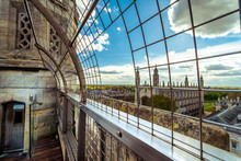 Blurry Panorama Of The City Cambridge From The Observation Tower Of St.Mary's Church. Picture Took Through Bars.