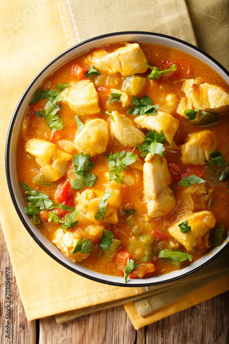 Brazilian traditional Bobo chicken with vegetables in coconut milk close-up. Vertical top view