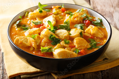 Bobo chicken stew with yuca, onion and pepper in coconut milk close-up in a bowl. horizontal