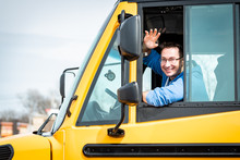 School Bus Driver Waving Out W...