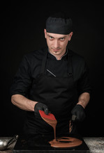 Chocolatier In Black Uniform In The Process Of Making Chocolates