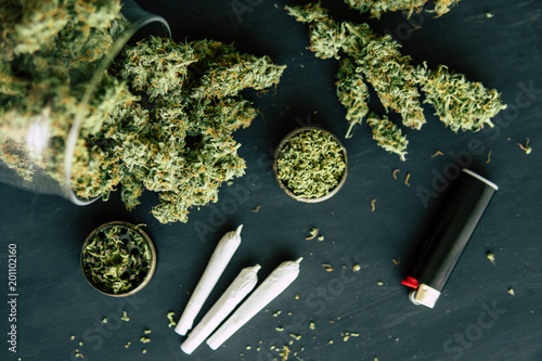 Vászonkép weed Joint Macro of cannabis buds marijuana with trichomes and crushed weed on a