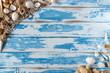 Sea shells frame on vintage blue wooden board. Summer holiday background.