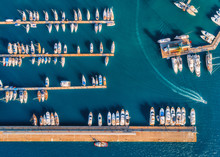 Aerial View Of Amazing Boats At Sunset. Minimalistic Landscape With Boats And Sea In Marina Bay. Top View From Drone Of Harbor With Yacht, Motorboat And Sailboat. Beautiful Port