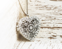 Heart Shaped Pendant On Pink B...