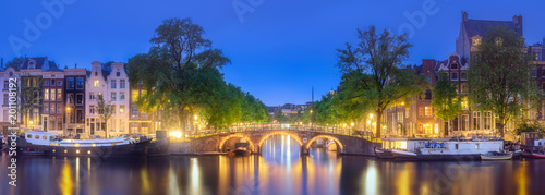 Photo  River, traditional old houses and boats, Amsterdam