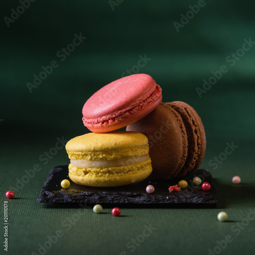 Foto op Canvas Macarons Delicious macarons on dark background