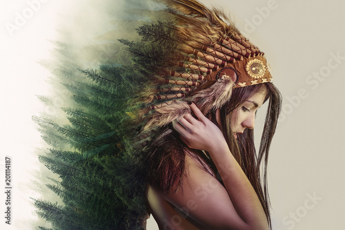Obraz na plátne double exposure, beautiful woman with indian plume of plume and a forest on the