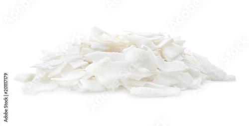 Fresh coconut flakes on white background