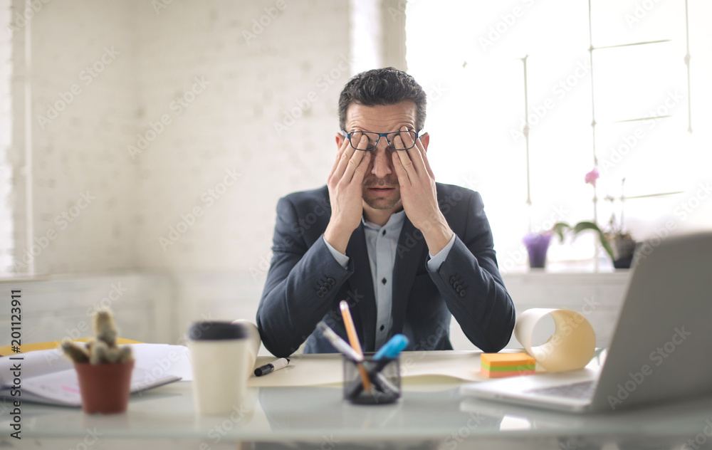 Fototapeta Desperate businessman, trying to find a solution to his problem