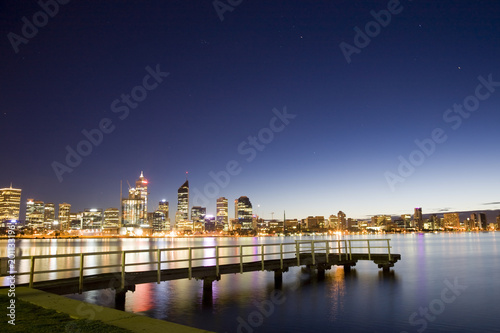 A view of Perth city across Swan River, with beautiful light reflections.