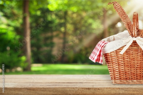 Staande foto Scandinavië Picnic Basket with napkin on nature background
