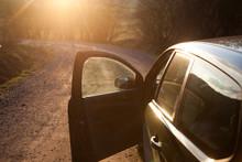Car On A Dirt Road At Sunset - Roadtrip