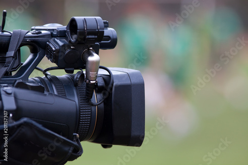 professional camera filming during sports event