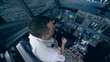 The pilot controls the plane in flight simulator.