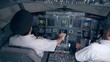 Two pilots get ready for a flight in a simulator. 4K.