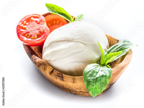 Buffalo mozzarella in the wooden bowl on white background.