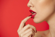 Red Glossy Lipstick On Red Bac...