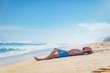 Man lying and enjoying on a sandy tropical beach.